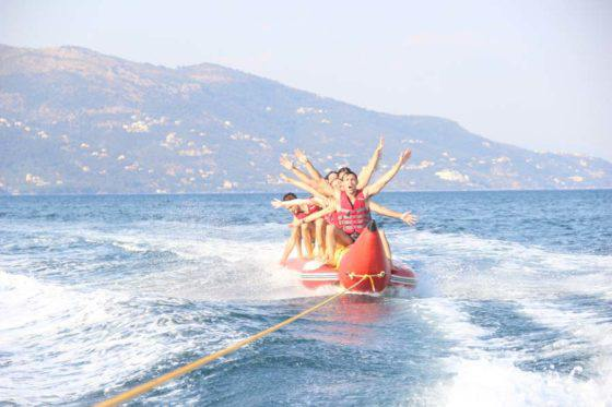 dassia-ski-club-watersports-corfu-inflatables-fun-dassia-sea-summer-beach-coast-adrenaline-yacht-towing-waves-sports-friends-family-summer-in-corfu-holidays-vacation-freetime-funtime-activities-banana