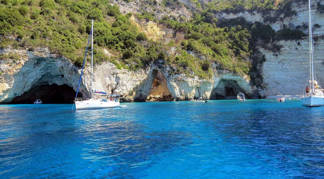 paxos-island-ionian-islands-port-gaios-caves-deep-blue-waters-cruises-boats-yachts-luxury-excursions-summer-holidays-vacation-Antipaxos-island-ionian-sea